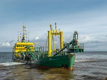 Hopper dredger vessel. Working in the bay Stock Image