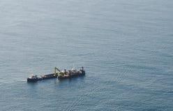 Hopper Dredger. Working near coast line of Tauranga Harbour. Landscape orientation stock photos