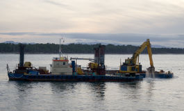 Hopper Dredger working in Tauranga Harbour. Hopper Dredger working in strait of Tauranga Harbour stock photos