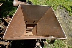 Hopper of an old time potato planter Stock Photo