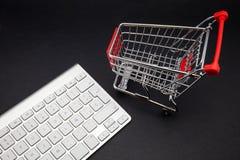 Hopping cart. Keyboard computer and shopping cart royalty free stock image