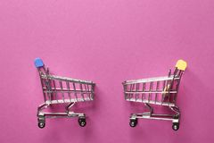 Hopping cart on a pink  background stock images