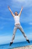 Hopping girl Stock Images