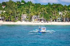 Hopping Tour boats with white beach from the water. BORACAY ISLAND, PHILIPPINES - November 18, 2017 : Hopping Tour boats with white beach from the water Stock Image