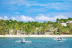 Hopping Tour boats with white beach from the water. BORACAY ISLAND, PHILIPPINES - November 18, 2017 : Hopping Tour boats with white beach from the water Stock Images