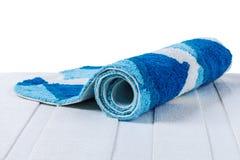 Hoprullad blå matta Royaltyfri Bild