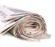 Hoprullad tidning Arkivbild