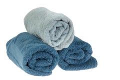 Hoprullade blåa handdukar Arkivfoto