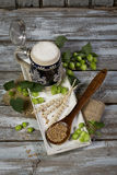 Hops and malt seeds and spikes traditional beer jug on cloth napkin Royalty Free Stock Photography