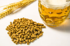Hops pellets with beer glass Royalty Free Stock Photography