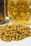 Hops pellets with beer glass Stock Photos