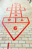Hopscotch. Game painted on the school pavement Stock Images