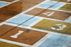 Hopscotch. Detail of worn hopscotch course, with numbers Royalty Free Stock Image