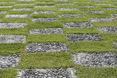 Hopscotch. Alternating pattern of green grass and grey stones Royalty Free Stock Photography