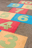 Hopscotch Background / Hopscotch / Hopscotch on Playground with Numbers on Ground Royalty Free Stock Images