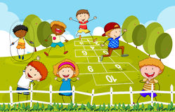 Hopscotch. Children playing hopscotch in the park Stock Photos