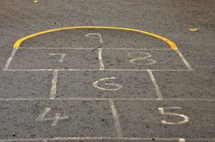Hopscotch grid numbers on asphalt Royalty Free Stock Image