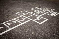 Hopscotch court with numbers from 1 to 10 drawn on the asphalt Royalty Free Stock Photo