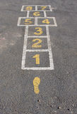 A hopscotch court painted on bitumen Stock Images