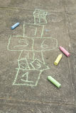 Hopscotch diagram and colored chalk Royalty Free Stock Photography