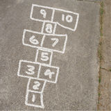 Hopscotch Game in Chalk on Sidewalk Stock Photo