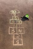 Hopscotch game drawn on the asphalt Royalty Free Stock Images