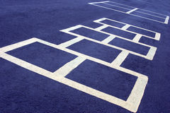Hopscotch game white on blue. Hopscotch game at a school, white board on blue Royalty Free Stock Photos