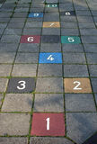 Hopscotch pavement game. A hopscotch set-up made with colored tiles Stock Image