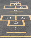 Hopscotch on playground Stock Images