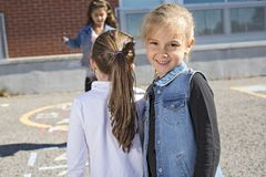 Hopscotch on the schoolyard with friends play together Royalty Free Stock Photo