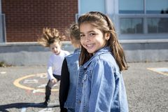 Hopscotch on the schoolyard with friends play together Stock Image