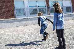 Hopscotch on the schoolyard with friends play together Stock Images