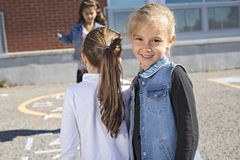 Hopscotch on the schoolyard with friends play together Royalty Free Stock Photos