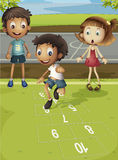Hopscotch time. Kids playing hopscotch in park Royalty Free Stock Images