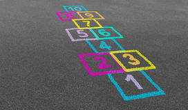 Hopscotch in un banco Immagine Stock