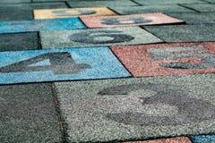 Hopsegummispielplatzbodenbelag Stockbild