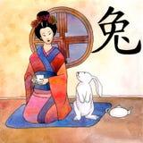 Horóscopo chino del año con el geisha fotos de archivo