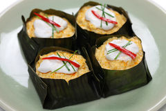 Hor mok, thai food. Steamed fish curry custard in banana leaf Royalty Free Stock Image