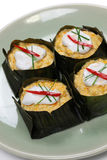 Hor mok, thai food. Steamed fish curry custard in banana leaf Stock Image