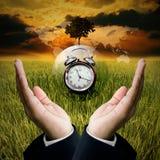 Hora de ahorrar el concepto del ambiente Foto de archivo libre de regalías