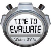 Hora de avaliar a avaliação do temporizador do cronômetro das palavras Fotografia de Stock
