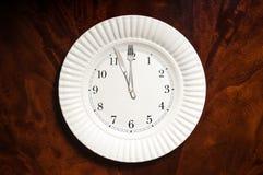 Hora de comer el reloj de la placa Foto de archivo