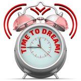 ¡Hora de soñar! El despertador con una inscripción Foto de archivo libre de regalías