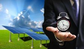 Hora de utilizar energía solar Imágenes de archivo libres de regalías