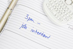 Hora para Job Interview Written In Diary Fotos de archivo