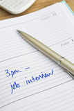 Hora para Job Interview Written In Diary Imágenes de archivo libres de regalías