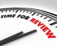 Hora para la revisión - reloj Imagen de archivo