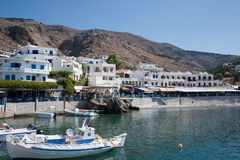 Hora Sfakion. Hóra Sfakíon or Sfakia is a town on the south coast of Crete, Greece. It is the capital of the remote and mountainous region of Sfaki Stock Photo