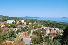 Hora village, Alonissos island. Looking down over the roofs of Hora village towards Patitiri on the Greek island of Alonissos. The village was badly damaged by stock photos