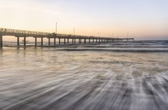 Horace Caldwell Pier Port Aransas texas. Long exposure of the waves coming in near the Horace Caldwell Pier in Port Aransas Texas stock image